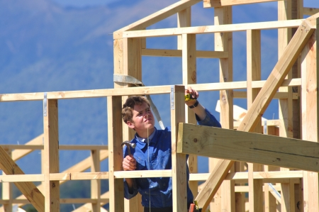builder measures and lines up framework on building