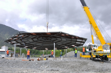 westland: A 70 tonne crane lifts the roof onto a new dairy, Westland, New Zealand