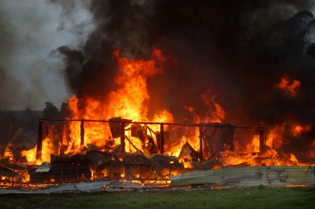 ruination: flames and smoke rise from burning building