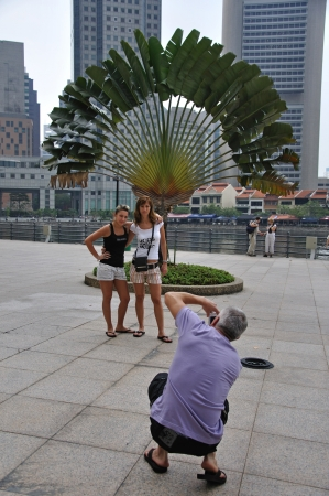 days gone by: SINGAPORE, FEBRUARY 13: Man photographs unidentified women on February 13, 2009 in Singapore city