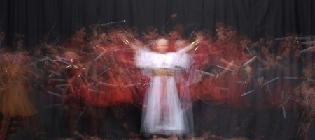 high priest: Armed warriors and pagan high priest caught on stage in high speed strobe lights Stock Photo