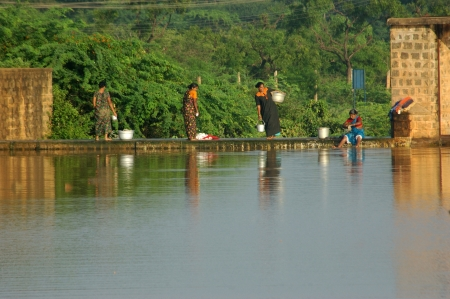 TAMIL NADU, INDIA, circa 2009: Unidentified women wash clothes in the village pond circa 2009 in Tamil Nadu, India. Much of Indias economy still relies on traditional tools and manual labour.