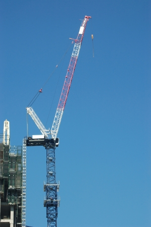 labouring: crane at work in central city consitruction site Stock Photo