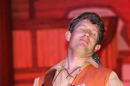 smug: smug pirate in stage performance Stock Photo