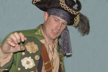 grimacing: grimacing  pirate captain in stage performance