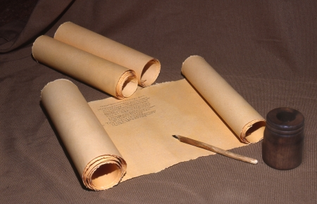 Ancient parchment scroll with Greek writing photo