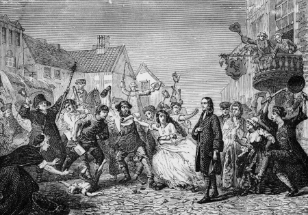 John Wesley in the midst of the riots of 1743 in Wednesbury, England,when local people tried to force him to stop preaching to new converts to Methodism, engraving from Selections from the Journal of John Wesley, 1891