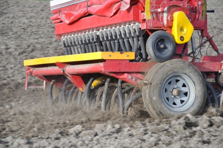 westland: Farmer drilling seed into pasture paddock, Westland, New Zealand