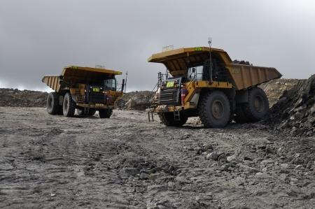 overburden: tiptrucks ready for work carting rock overburden at an open cast coal mine Editorial