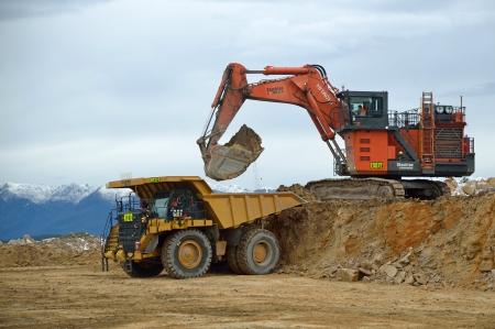 overburden: WESTPORT, NEW ZEALAND, JULY 12, 2013: A 190 ton digger loads a 130 ton truck with rock overburden at Stockton open cast coal mine on July 12, 2013 near Westport, New Zealand. Stockton is the countrys largest open cast coal mine.