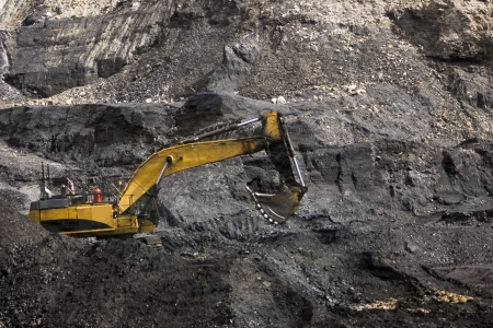 40 ton excavator extracting high grade coal from a seam in Westland, New Zealand photo