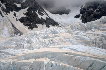 franz josef: Smoke from bushfires in Australia causes brown discolouration on the snow of the Franz Josef Glacier, Westland, New Zealand  Stock Photo