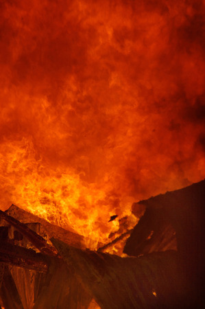 ruination: flames and smoke rise from burning farm building
