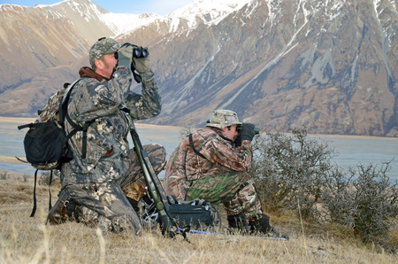 Hunters scoping for Himalayan tahr in the Southern Alps of New Zealand Stock Photo - 26291087