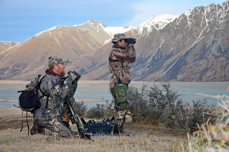 binoculars: Hunters scoping for Himalayan tahr in the Southern Alps of New Zealand