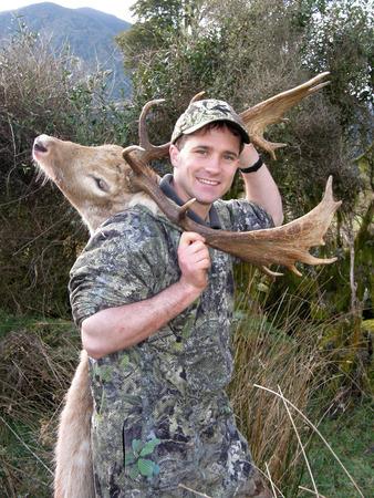 succesful: Succesful hunter with white fallow deer, Dama dama, Westland, New Zealand Stock Photo