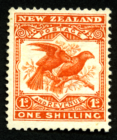 shilling: 1907 New Zealand one shilling pictorial stamp featuring a kea and a kaka