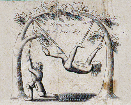 Illustration from a 1583 edition of Foxes Book of Martyrs, showing Papists torturing Protestants, in this case by being torn apart by trees.
