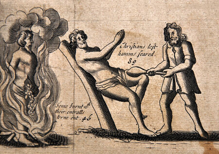 Illustration from a 1583 edition of Foxes Book of Martyrs, showing Papists torturing Protestants, in this case by burning while their entrails are torn out, and by having their legs seared with hot irons.