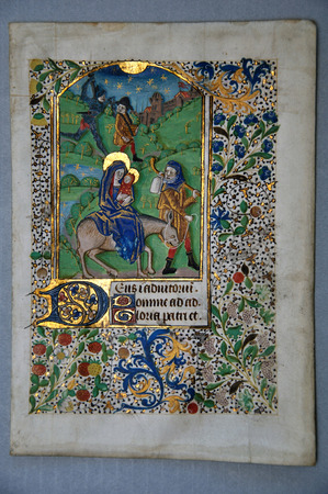 Page from a 15th Century Book of Hours, written in France on vellum, showing Joseph and Mary taking Jesus to Egypt. (Fragment 19) From the Reed Rare Books Collection in Dunedin, New Zealand.