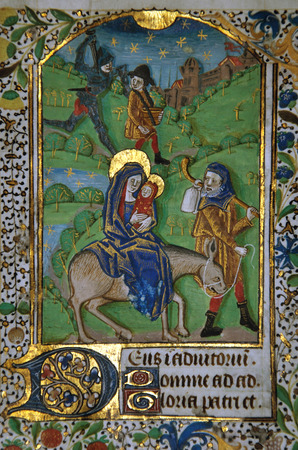 vellum: Detail of a page from a 15th Century Book of Hours, written in France on vellum, showing Joseph and Mary taking Jesus to Egypt. (Fragment 19) From the Reed Rare Books Collection in Dunedin, New Zealand.