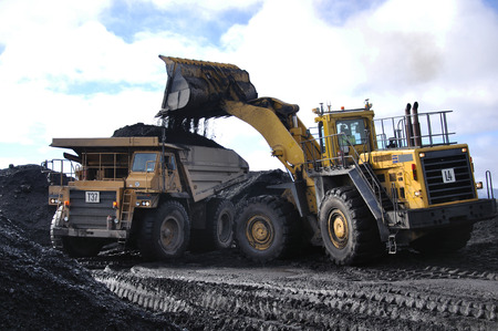 Truck loaded up with coal at an open cast Coal Mine, Westland, New Zealand Editorial