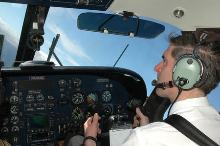 pilot at aircraft cockpit in Dornier 228 Фото со стока