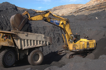 nonrenewable: WESTPORT, NEW ZEALAND, CIRCA 2007: Digger loads up a truck with high grade coal at Stockton Coal Mine, West Coast, South Island, New Zealand