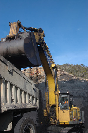 WESTPORT, NEW ZEALAND, CIRCA 2007: Digger loads up a truck with high grade coal at Stockton Coal Mine, West Coast, South Island, New Zealand