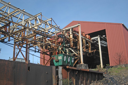 WESTPORT, NEW ZEALAND, CIRCA 2007: Buckets on the aerial ropeway carry coal down to the the railway terminal at Stockton Coal Mine, West Coast, South Island, New Zealand