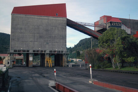 WESTPORT, NEW ZEALAND, CIRCA 2007: Coal storage facilities at the rail terminal for Stockton Coal Mine, West Coast, South Island, New Zealand