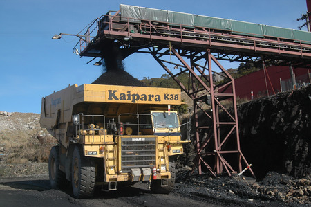 WESTPORT, NEW ZEALAND, CIRCA 2007: Truck loads up with 100 ton of coal at Stockton Coal Mine, West Coast, South Island, New Zealand