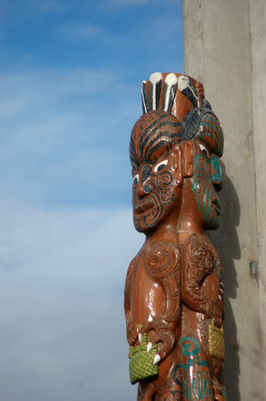 Carved column with Maori warriors, Christchurch, Canterbury, New Zealand.
