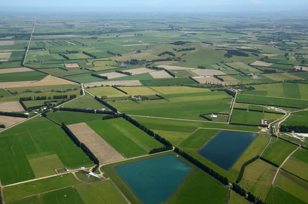 effluent: Aerial of dairy and cropping farms in Canterbury, South Island, New Zealand. The large ponds collect effluent from the dairy farms for irrigation.