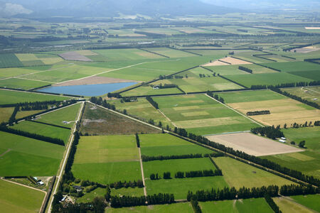 dairying: Aerial of complex intersection amid cropping farms in Canterbury, South Island, New Zealand Stock Photo