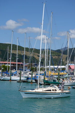 pleasure craft: NELSON, NEW ZEALAND, DECEMBER 23, 2014: An unidentified man takes his sail boat from the Nelson marina in New Zealand on December 23, 2014
