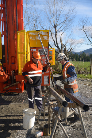 hydrocarbon: Drilling crewmen prepare to remove a core sample from a rig drilling near Greymouth, New Zealand. Editorial