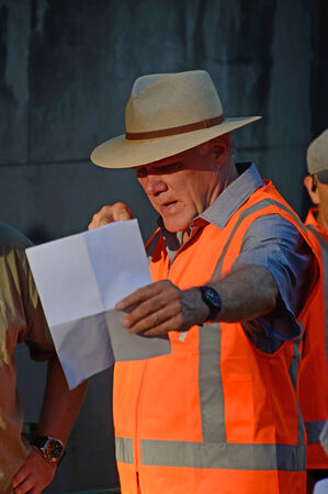 film director: AUCKLAND, NEW ZEALAND, JANUARY 18, 2015: American Film Director Joe Johnston consults his crew while directing a spoiler for a television series in Auckland, New Zealand on January 18, 2015. Johnston has directed Jurassic Park III (2001), The Rocketeer (1