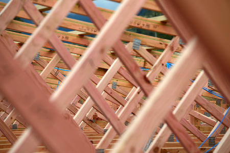 roof framing: background of treated timber framing in the roof of a new building Stock Photo