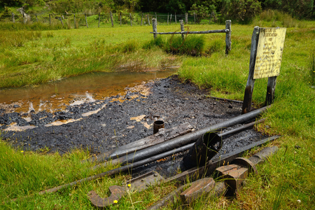 hydrocarbon: An abandoned oil well still seeps out light crude oil after a hundred years Stock Photo