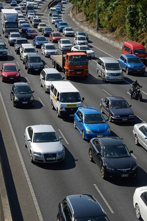 congested: AUCKLAND, NEW ZEALAND, JANUARY 19, 2015: Congested outgoing traffic in the afternoon rushhour on an Auckland motorway, Northland, New Zealand on January 19, 2015