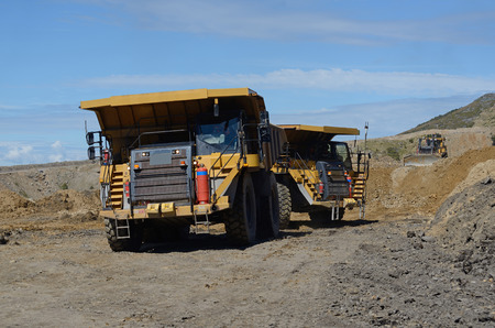 overburden: 130 ton loads of rock overburden are carried away at an open cast coal mine