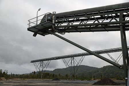 conveyors: GREYMOUTH, NEW ZEALAND, MAY 20, 2015: Conveyors stand idle at the  Pike River Coal mine on May 20, 2015 near Greymouth, New Zealand, days before it was demolished. 29 miners died at the mine in 2010 and it cannot be reopened. Editorial