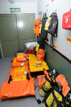 readiness: GREYMOUTH, NEW ZEALAND, MAY 20, 2015: First aid and trauma kits packed and ready to go at a working coal mine near Greymouth, New Zealand Editorial