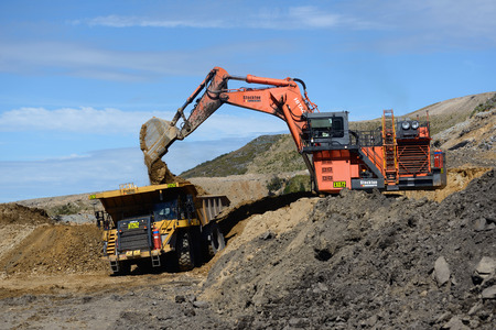 WESTPORT, NEW ZEALAND, MARCH 11, 2015: 190 ton digger loads rock from a layer of overburden at open cast coal mine on March 11, 2015 near Westport, New Zealand Editorial