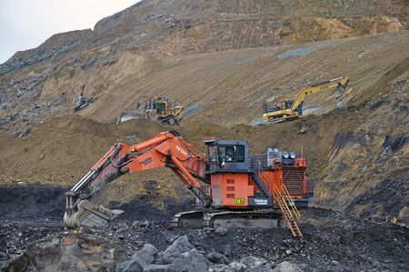 open cast mine: WESTPORT, NEW ZEALAND, MARCH 4, 2015:Machinery at work at an open cast coal mine on March 4, 2015 near Westport, New Zealand
