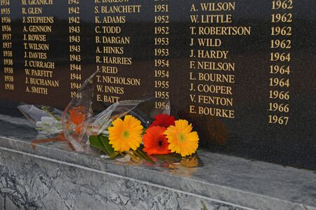 fatality: GREYMOUTH, NEW ZEALAND, CIRCA 2013: background of names from a Greymouth memorial to coal miners who have died in mining accidents on the West Coast of New Zealand Editorial