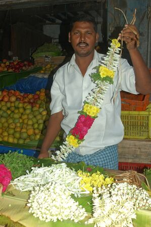 tamil nadu: TAMIL NADU, INDIA, circa 2009: man selling flower wreaths in Tamil Nadu, South India