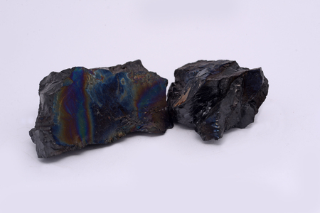 carboniferous: Pieces of anthracite from a New Zealand mine, known to the miners as rainbow coal or peacock coal. Anthracite is the purest form of coal and it appears in about 1% of coal deposits around the world. Stock Photo