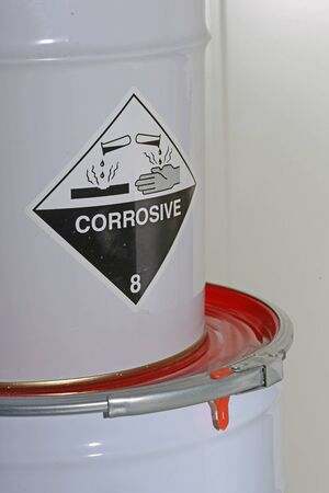 epoxy: Drums of epoxy wait for mixing on a flooring job Stock Photo